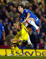 Photo: Scott Heavey.<br /> Chelsea v Birmingham City. FA Barclaycard Premiership. 18/01/2004.<br /> Frank Lampard takes a ride on Robbie Savage after shooting over the Birmingham bar
