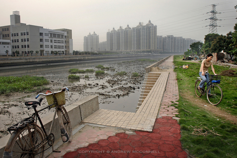 New apartments and factories line the route of a polluted river in the suburbs of Guangzhou, southern China.