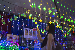 "June 17, 2017 - Kuala Lumpur, Malaysia - A muslims look at lamps for a preparation to celebrating Eid-fitri in Malaysia on JUNE 18, 2017 in Kuala Lumpur, ""Ketupat"" Ornaments Lighting is Symbolic decorations for Muslim in Malaysia to Celebrating Incoming Eid-fitri, Malaysia Muslims spend extra on food and new clothes for Eid al-Fitri, the most important festival for muslims , which marks the end of Ramadan spending seems to be holding up in Malaysia. (Credit Image: © Mustaqim Khairuddin/NurPhoto via ZUMA Press)"