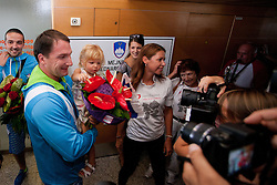Primoz Kozmus with his family during reception of Slovenian Olympic team, on August 10, 2012 in Airport Joze Pucnik, Brnik, Slovenia.  (Photo by Matic Klansek Velej / Sportida)