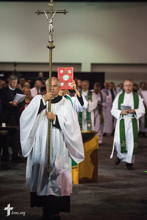 The Rev. Allen Braun, pastor of Mount Hulda Lutheran Church in Cole Camp, Mo., carries the processional crucifix Opening Divine Service of the 66th Regular Convention of The Lutheran Church–Missouri Synod on Saturday, July 9, 2016, at the Wisconsin Center in Milwaukee. LCMS/Michael Schuermann