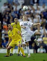 Photo: Jed Wee.<br /> Leeds United v Preston North End. Coca Cola Championship. Play-off, First Leg. 05/05/2006. <br /> <br /> Leeds' Eirik Bakke (R) wins a header from Preston's Brian O'Neil.