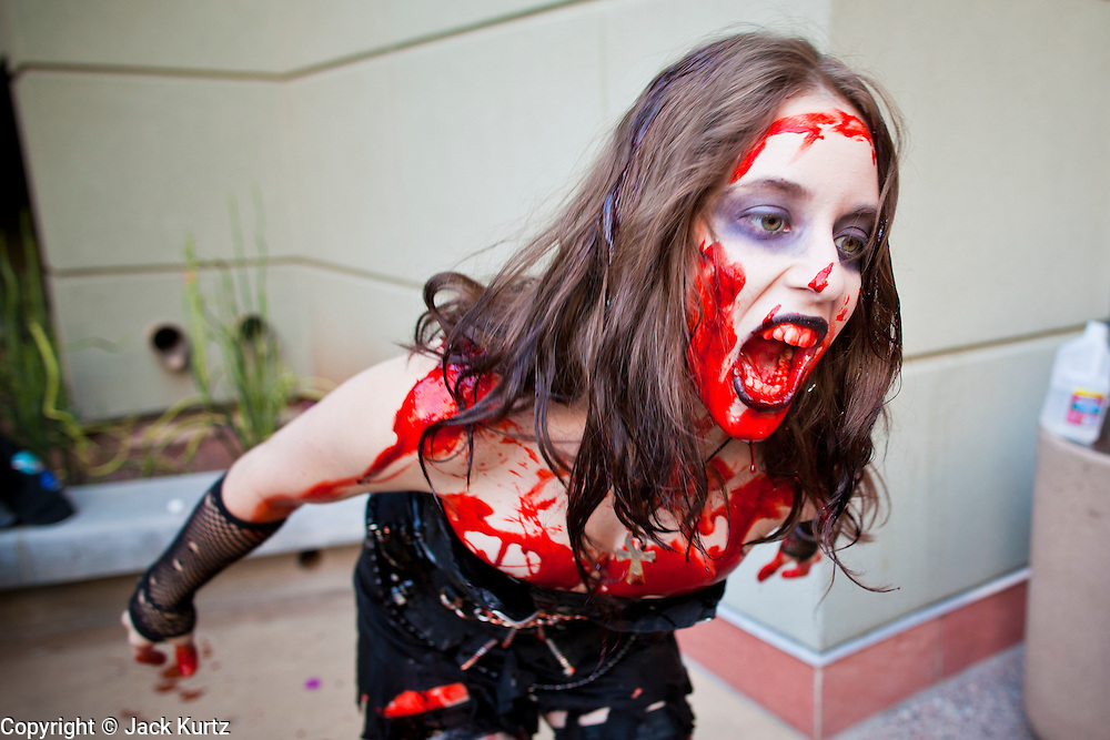 27 MAY 2011 - PHOENIX, AZ: MAE CATES, from Phoenix, participates in the Phoenix Comicon Zombie Walk Friday. Phoenix Comicon opened Thursday and featured a Zombie Walk through downtown Phoenix Friday night. Hundreds of people participated in the Zombie Walk, both as Zombies and as Zombie hunters. This year's Comicon includes appearances by Leonard Nimoy (Star Trek), Adam Baldwin (Firefly and Chuck), Stan Lee (Marvel Comics), Nicholas Brendon (Buffy the Vampire Slayer) and others. Activities include costuming workshops, role playing games and a Geek Prom.     Photo by Jack Kurtz