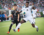 Mexico striker Uriel Antuna (22) is taken down by Cuba midfielder Jean Rodríguez (14) in a game between Mexico and Cuba during a CONCACAF Gold Cup soccer match in Pasadena, Calif., Saturday, June 15, 2019. Mexico defeated Cuba 7-0. (Ed Ruvalcaba/Image of Sport)