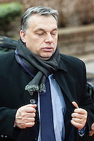 Viktor Orban, Prime Minister of Hungary, arrives looking tired, at a EU Budget summit at the European Council building after a break in Brussels, Friday, Feb. 8, 2013. A European Union summit to decide EU spending for the next seven years entered a second day after all-night negotiations left a standoff over spending unresolved. The leaders of the 27 nations inched toward a compromise Friday that would leave their common budget with a real-term cut for the first time in the EU's history.