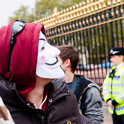 LONDON, UK - 18th May 2012: Occupy London and Anonymous protesters in front of Buckingham Palace denouncing the presence of the King of Bahrain and other country leaders in visit at Buckingham Palace for the Queen's Jubilee.