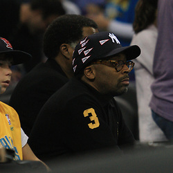 28 January 2009: Film maker Spike Lee watches courtside during a 94-81 win by the New Orleans Hornets over the Denver Nuggets at the New Orleans Arena in New Orleans, LA. The Hornets wore special throwback uniforms of the former ABA franchise the New Orleans Buccaneers for the game as they honored the Bucs franchise as a part of the NBA's Hardwood Classics series. .