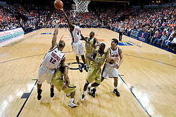 Virginia guard/forward Mamadi Diane (24) grabs a rebound against GT.  The Virginia Cavaliers men's basketball team fell to the Georgia Tech Yellow Jackets 92-82 in overtime at the John Paul Jones Arena in Charlottesville, VA on January 27, 2008.