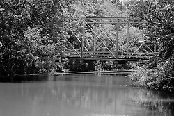 23 August 2013:   Swisher Bridge, a steel beam bridge, spans Salt Creek before it flows into Clinton Lake.  Swisher Bridge was restored in 1987.  It has a deck made of wood and is crossable by motor vehicles.