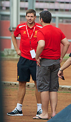 JAKARTA, INDONESIA - Wednesday, July 17, 2013: Liverpool's captain Steven Gerrard meets Daily Mail reporter Dominic King as his side take a walk around the Gelora Bung Karno Stadium ahead of their game against Indonesia as part of their Preseason Tour. (Pic by David Rawcliffe/Propaganda)