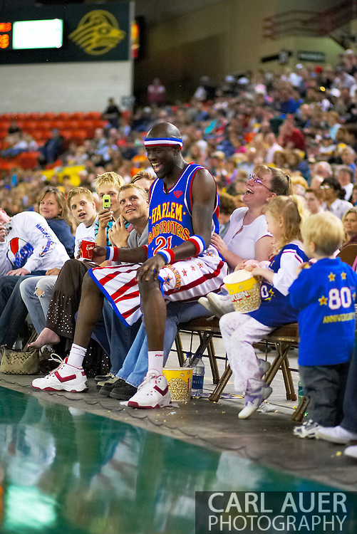 "04 May 2006: Kevin ""Special K"" Daley watches the action while sitting on a fan at the Harlem Globetrotters vs the New York Nationals at the Sulivan Arena in Anchorage Alaska during their 80th Anniversary World Tour.  This is the first time in 10 years that the Trotters have visited Alaska."