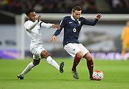 Raheem Sterling of England and Yohan Cabaye of France during the Breast Cancer Care International Friendly match at Wembley Stadium, London<br /> Picture by Daniel Hambury/Focus Images Ltd +44 7813 022858<br /> 17/11/2015