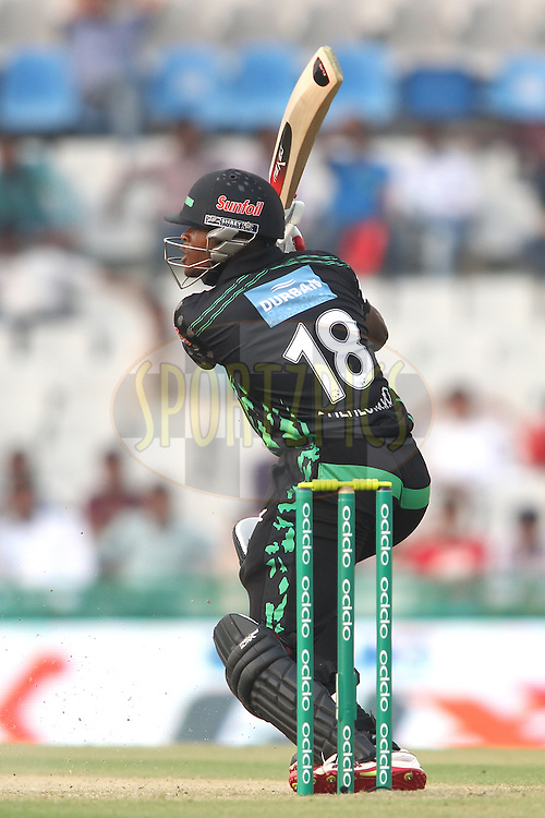 Andile Phehlukwayo of the Dolphins square drives a delivery  during match 4 of the Oppo Champions League Twenty20 between the Dolphins and the Perth Scorchers held at the Punjab Cricket Association Stadium, Mohali, India on the 20th September 2014<br /> <br /> Photo by:  Shaun Roy / Sportzpics/ CLT20<br /> <br /> <br /> Image use is subject to the terms and conditions as laid out by the BCCI/ CLT20.  The terms and conditions can be downloaded here:<br /> <br /> http://sportzpics.photoshelter.com/gallery/CLT20-Image-Terms-and-Conditions-2014/G0000IfNJn535VPU/C0000QhhKadWcjYs