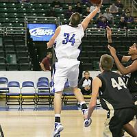 Pioneer forward Trevor Tune (34) comes underneath the basket to score against Lancer center Luke Kreienkamp (44)