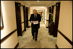 Mayor of London Boris Johnson reads through  to his speech to the England Cricketers in Mumbai, as he walks from his hotel room, Wednesday November 28, 2012. Photo by Andrew Parsons / i-Images