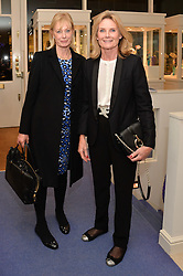 Left to right, LADY JACQUELINE RUFUS ISAACS and LADY MARY-GAYE CURZON at a preview of the latest collections by jewellery designer Kiki Mcdonough and fashion label Beulah held at Kiki McDonough Jewellery, 12 Symons Street, London on 5th March 2014.