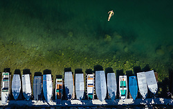 THEMENBILD - eine Frau schwimmt im Zeller See nahe eines Bootssteges, aufgenommen am 30. Juni 2019 in Zell am See, Österreich // a woman swims in the Zeller lake near a jetty, Zell am See, Austria on 2019/06/30. EXPA Pictures © 2019, PhotoCredit: EXPA/ JFK