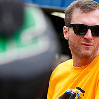 Dale Earnhardt Jr hangs out in the garage during practice for the Consumers Energy 400 at Michigan International Speedway in Brooklyn, Michigan.