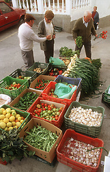 Vegetables for sale in street in Tolox; Andalucia  garlic; beans; lemons; tomatoes and onions,