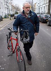 © Licensed to London News Pictures. 03/12/2015. London, UK. Labor party leader JEREMY CORBYN leaving his London home pushing his bike the morning after the UK parliament voted to bomb in Syria. Photo credit: Ben Cawthra/LNP