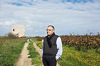 GUAGNANO, ITALY - 10 NOVEMBER 2016: Gianvito Rizzo (53), inventor of the sommelier courses at Lecce prison and chief executive officer at the Feudi di Guagnano, the wine cellar that offered their wines for the classes, poses for a portrait in the vineyard of Leonardo di Prato of the wine house Feudi di San Guaganano, where the Negramaro wine is produced, in Guagnano near Lecce, Italy, on November 10th 2016.<br /> <br /> Here a group of ten high-security female inmates and aspiring sommeliers , some of which are married to mafia mobsters or have been convicted for criminal association (crimes carrying up to to decades of jail time), are taking a course of eight lessons to learn how to taste, choose and serve local wines.<br /> <br /> The classes are part of a wide-ranging educational program to teach inmates new professional skills, as well as help them develop a bond with the region they live in.<br /> <br /> Since the 1970s, Italian norms have been providing for reeducation and a personalized approach to detention. However, the lack of funds to rehabilitate inmates, alongside the chronic overcrowding of Italian prisons, have created a reality of thousands of incarcerated men and women with little to do all day long. Especially those with a serious criminal record, experts said, need dedicated therapy and professionals who can help them.
