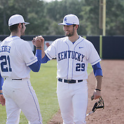 The University of Kentucky's Robert Zeigler, left and Kyle Cody greet each other before their season opener again the University of Virginia. The university of Kentucky faced the University of Virginia in the opening game of the Hughes Brothers Challenge Friday February 14, 2014 at Brooks Field on the campus of the University of North Carolina at Wilmington in Wilmington, N.C. (Jason A. Frizzelle)