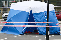 © Licensed to London News Pictures. 02/04/2019. London, UK. Crime scene on Grafton Road, junction with Vicars Road in Kentish Town, north west London where a man in his 20s was found stabbed around 8.30pm on Monday 1 April 2019. He was pronounced dead at the scene. Photo credit: Dinendra Haria/LNP