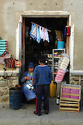 Boy buying a cup in the Tarabuco market, Chuquisaca, Bolivia