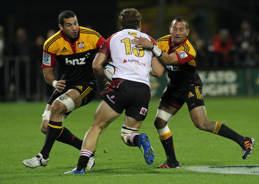 Chiefs Kane Thompson and Chiefs Aaron Cruden tackle Lion's Jaco Taute in a Super Rugby match at Ecolight Stadium, Pukekohe, Auckland, New Zealand, Saturday, May 05, 2012.  Credit:SNPA / David Rowland