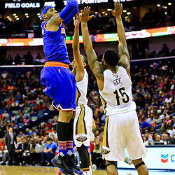 Mar 28, 2016; New Orleans, LA, USA; New York Knicks forward Carmelo Anthony (7) shoots over New Orleans Pelicans forward Alonzo Gee (15) and guard Tim Frazier (2) during the second quarter of a game at the Smoothie King Center. Mandatory Credit: Derick E. Hingle-USA TODAY Sports
