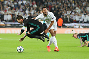 Tottenham Hostpur attacker Moussa Dembele (19) fouling Real Madrid defender Sergio Ramos (4) and getting a yellow card during the Champions League match between Tottenham Hotspur and Real Madrid at Wembley Stadium, London, England on 1 November 2017. Photo by Matthew Redman.