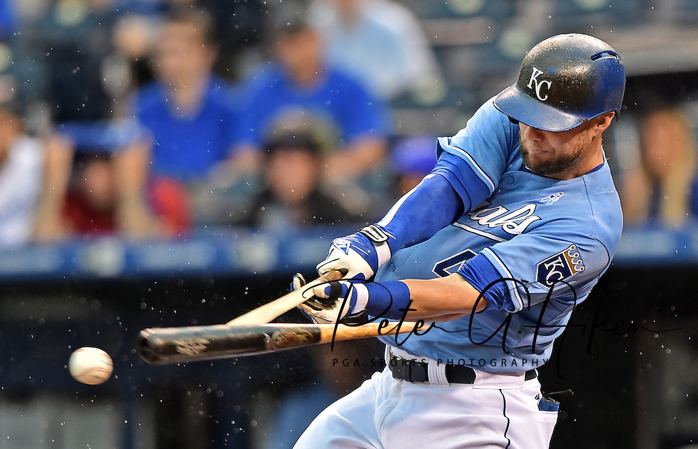 Kansas City Royals left fielder Alex Gordon hits a broken bat single against the Boston Red Sox during the fourth inning at Kauffman Stadium.