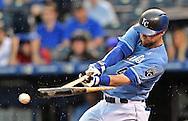 Kansas City Royals left fielder Alex Gordon hits a broken bat single against the Boston Red Sox during the fourth inning at Kauffman Stadium.