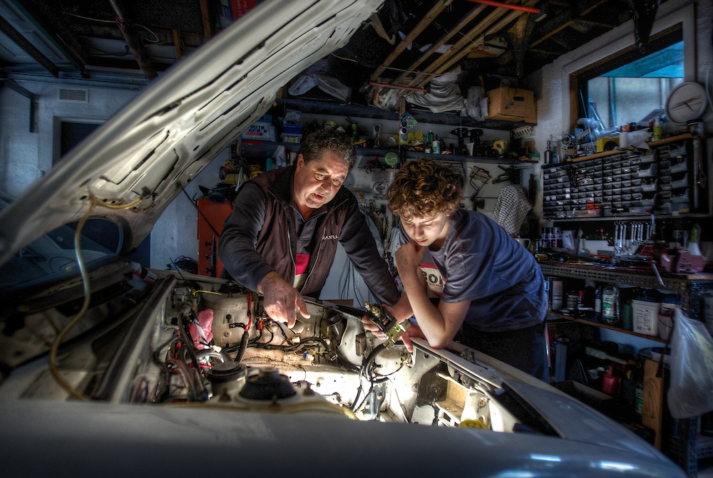 Father-and-son team Mario Giannattilio and his 12 year old son Michael bought a 1990 Ford Capri late last year to convert to electricPic By Craig Sillitoe CSZ/The Sunday Age.22/7/2011 melbourne photographers, commercial photographers, industrial photographers, corporate photographer, architectural photographers, This photograph can be used for non commercial uses with attribution. Credit: Craig Sillitoe Photography / http://www.csillitoe.com<br />