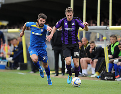 Bristol Rovers' Lee Brown is chased down by AFC Wimbledon's George Francomb - Photo mandatory by-line: Dougie Allward/JMP - Mobile: 07966 386802 05/04/2014 - SPORT - FOOTBALL - Kingston upon Thames - Kingsmeadow - AFC Wimbledon v Bristol Rovers - Sky Bet League Two