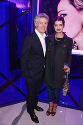 JOHN FRIEDA and PIXIE GELDOF at a party to celebrate 25 years of John Frieda held at Claridge's, Brook Street, London on 29th October 2013.
