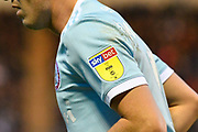 A sky bet badge on an Accrington Stanley players shirt sleeve during the EFL Sky Bet League 1 match between Plymouth Argyle and Accrington Stanley at Home Park, Plymouth, England on 22 December 2018.