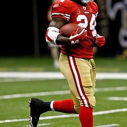 August 12, 2011; New Orleans, LA, USA; San Francisco 49ers running back Anthony Dixon (24) prior to kickoff of a preseason game against the New Orleans Saints at the Louisiana Superdome. Mandatory Credit: Derick E. Hingle