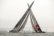 USA - Newport, RI - America's cup boat rigs cross, as a tacking duel unfolds on the upwind leg a race for the UBS trophy.