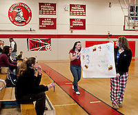"Amanda Goupil and Chelsea Parent try drumming up business for the 4th annual  NH JAG""Best Pizza in Town Contest Thursday evening during the boys Varsity Basketball game at Laconia High School.  (Karen Bobotas/for the Laconia Daily Sun)"