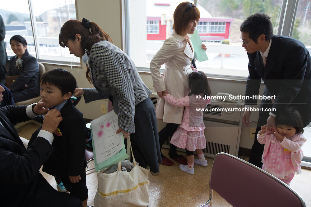 School and kindergarten entrance ceremony for Kawauchi town takes place in the community centre, in Kawauchi, Japan on Friday 6th April 2012. Restrictions on residents living in, and visiting their homes and business in Kawauchi, have just been relaxed and approximately 533 people have moved back out of an original town population of 2,856. The residents initially left due to fears over high levels of nuclear radiation contamination from the explosions at the Fukushima Daiichi nuclear plant which is approximately 25-30km away from the town. The nuclear plant exploded in the aftermath of the earthquake and tsunami which hit the Tohoku coastline on 11th March 2011.