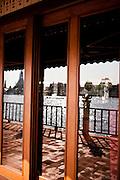 River reflected in windows of dining pavilion at Chakrabongse Villas