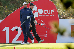 Oct 19, 2018-Jeju, South Korea-MARC LEISHMAN of Australia and ERNIE ELS of Republic of South Africa action on the 12th tee during the PGA Golf CJ Cup Nine Bridges Round 2 at Nine Bridges Golf Club in Jeju, South Korea.