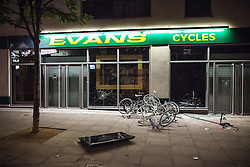 © Licensed to London News Pictures . 09/08/2011 . London , UK . Evans Cycles in Camden Town is looted during a 3rd night of rioting and looting in London , following a protest against the police shooting of Mark Duggan in Tottenham . Photo credit : Joel Goodman/LNP