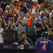Wilmer Flores and Juan Uribe, New York Mets, are applauded by Mets fans as they return to the dugout after both players scored on Juan Uribe's home run during the New York Mets Vs New York Yankees MLB regular season baseball game at Citi Field, Queens, New York. USA. 18th September 2015. Photo Tim Clayton