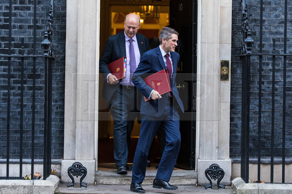 © Licensed to London News Pictures. 28/11/2017. London, UK. Defence Secretary Gavin Williamson (R) and Transport Secretary Chris Grayling (L) leave 10 Downing Street after the weekly Cabinet meeting. Photo credit: Rob Pinney/LNP