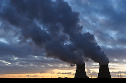 Cooling towers vent steam, at the Port of Antwerp, in Antwerp, Belgium, Friday, Jan. 6, 2012. (Photo © Jock Fistick)
