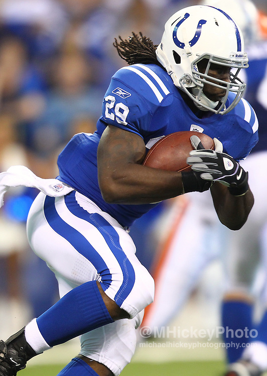Sept. 18, 2011; Indianapolis, IN, USA; Indianapolis Colts running back Joseph Addai (29) runs the ball against the Cleveland Browns at Lucas Oil Stadium. Cleveland defeated Indianapolis 27-19. Mandatory credit: Michael Hickey-US PRESSWIRE