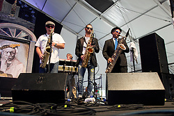 30 April 2015. New Orleans, Louisiana.<br /> The New Orleans Jazz and Heritage Festival. <br /> No names for Saxophonists with Eric Lindell at the Blues tent.<br /> Photo; Charlie Varley/varleypix.com