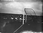28/09/1960<br /> 09/28/1960<br /> 28 September 1960<br /> Soccer International: Ireland v Wales at Dalymount Park, Dublin. Wales won the game 3-2. Terry Medwin, Welsh No.7 walking the ball into the Irish net for his sides 2nd goal as the Irish defence is caught napping.